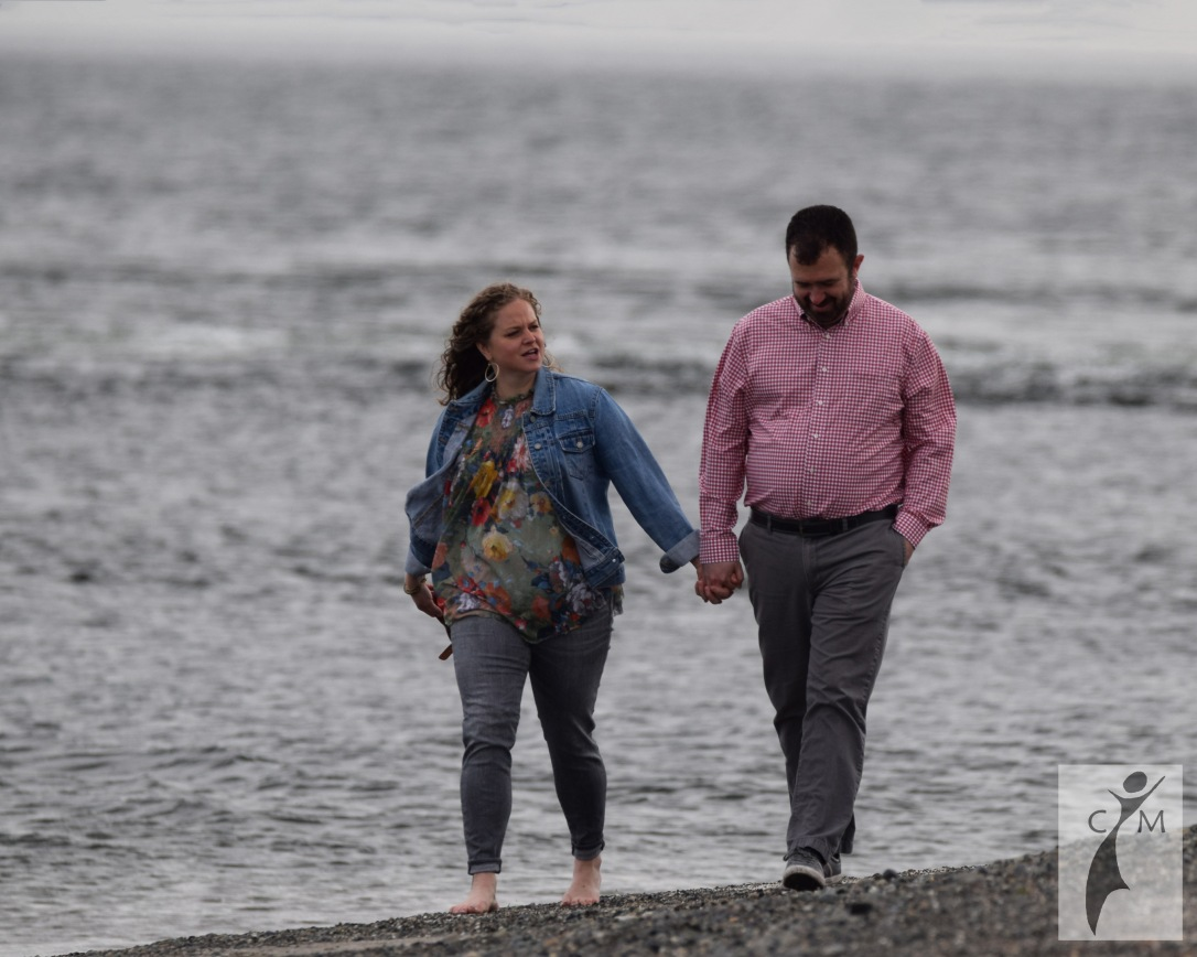 Young couple walking on beach Mukilteo Washington