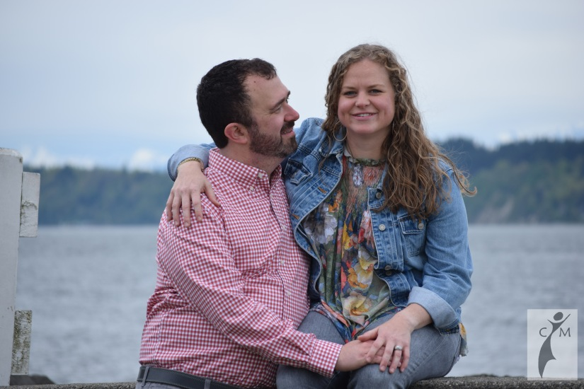 Young couple sitting near the beach Mukilteo Washington