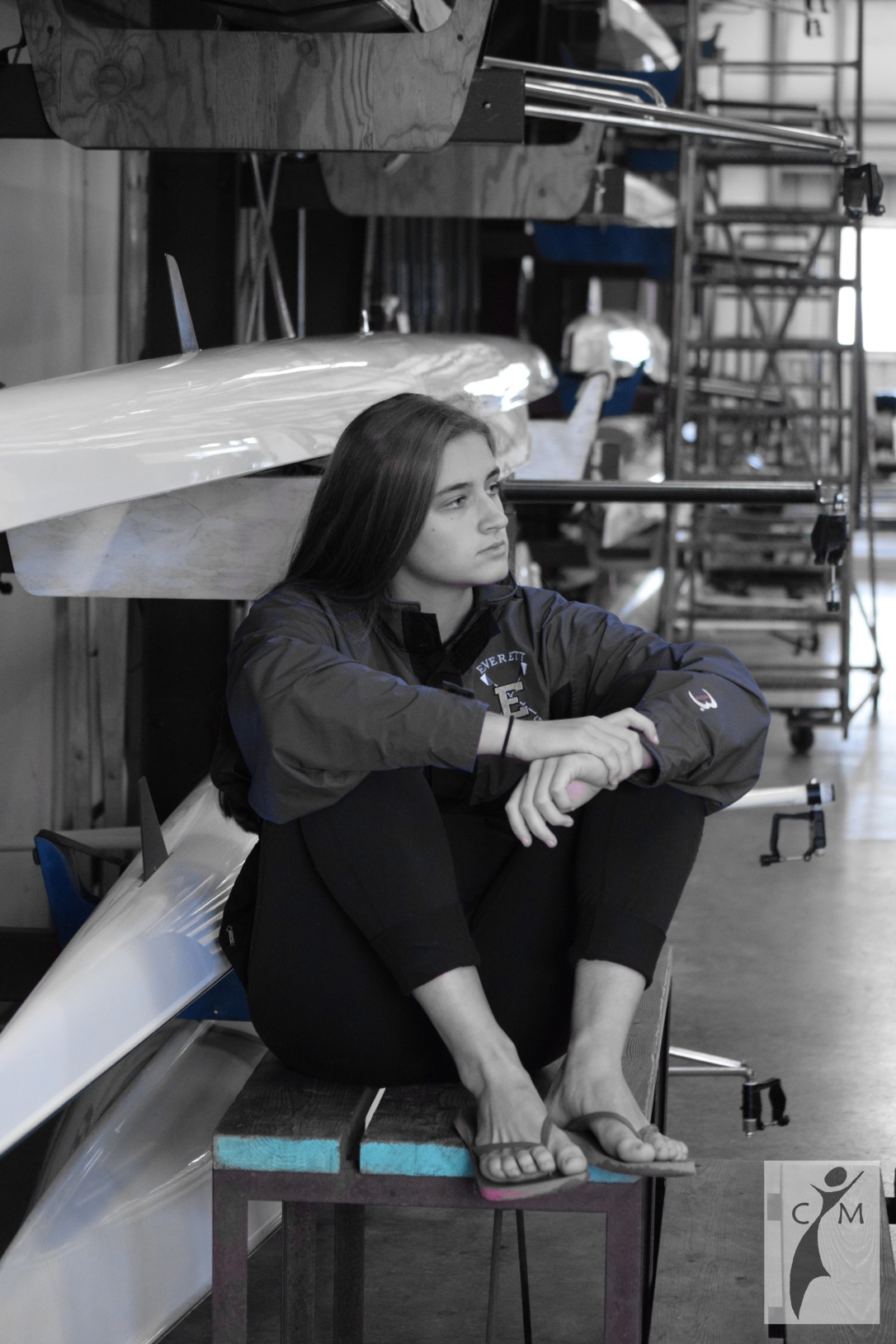 Young woman in boathouse
