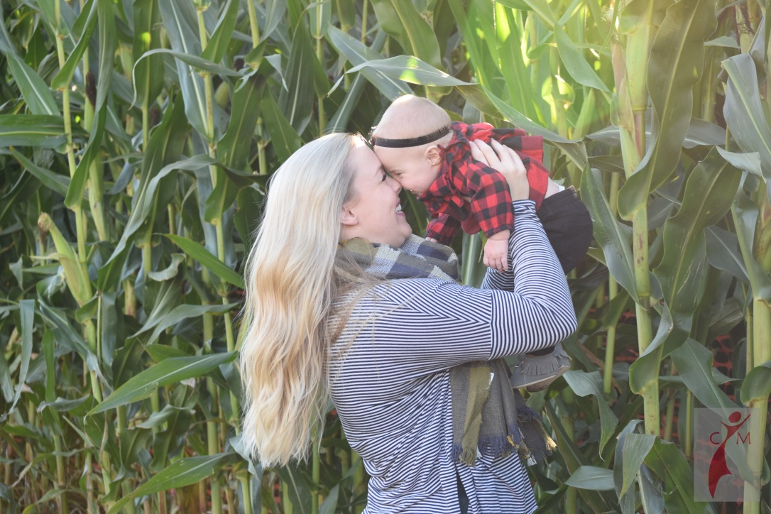 Mom and daughter in corn maze