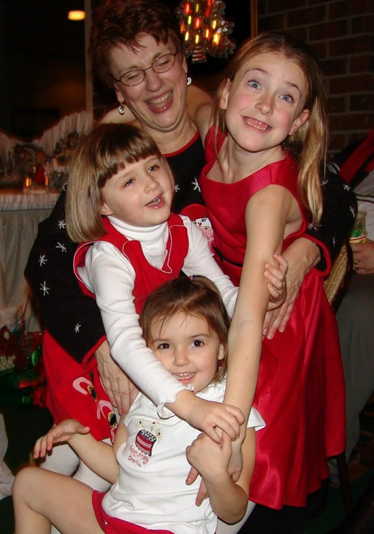 Girls hugging Grandma at Christmas Party